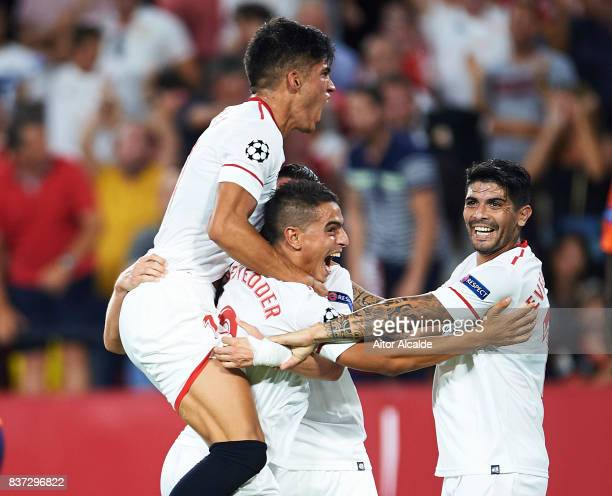 Sergio Escudero of Sevilla FC celebrates after scoring with his team mates Wissam Ben Yedder Joaquin Correa and Ever Banega during the UEFA Champions...