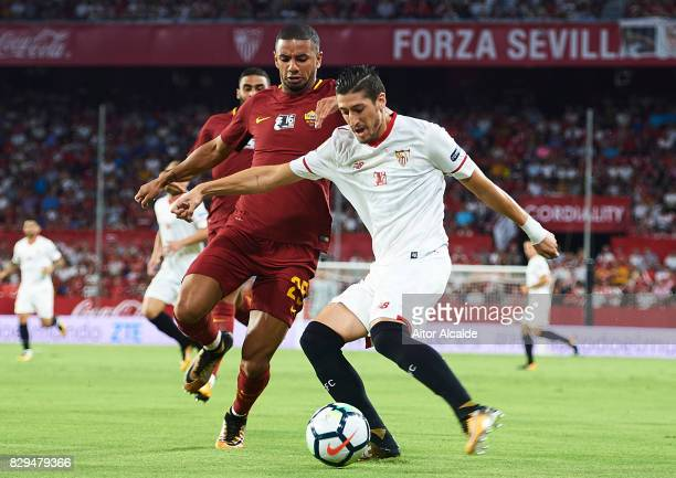 Sergio Escudero of Sevilla FC competes for the ball with Bruno Peres of AS Roma during a Pre Season Friendly match between Sevilla FC and AS Roma at...
