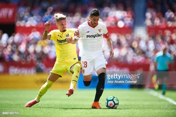 Sergio Escudero of Sevilla FC competes for the ball with Samuel Castillejo of Villarreal CF during the La Liga match between Sevilla and Villarreal...