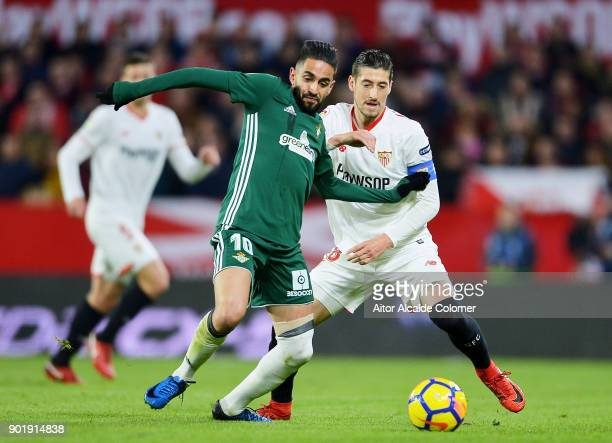 Sergio Escudero of Sevilla FC duels for the ball with Ryad Boudebouz of Real Betis during the La Liga match between Sevilla FC and Real Betis...