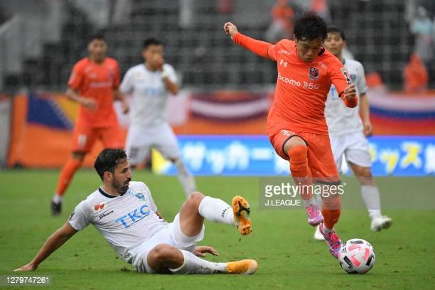 Sergio ESCUDERO of Tochigi SC and Shintaro SHIMADA of Omiya Ardija battle for the ball during the J.League Meiji Yasuda J2 match between Omiya Ardija...