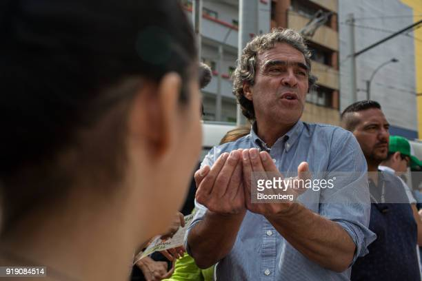 Sergio Fajardo pattendeeial candidate for the Coalicion Colombia Party and former mayor of Medellin speaks with an attendee during a campaign event...
