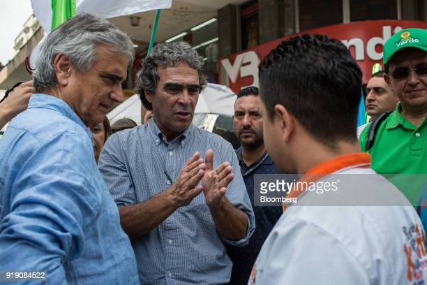 Sergio Fajardo pattendeeial candidate for the Coalicion Colombia Party and former mayor of Medellin center speaks with an attendee while Ivan...