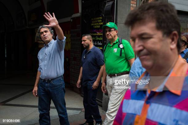 Sergio Fajardo presidential candidate for the Coalicion Colombia Party and former mayor of Medellin left waves to attendees during a campaign event...