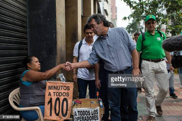 Sergio Fajardo presidential candidate for the Coalicion Colombia Party and former mayor of Medellin center shakes hands with a street vendor during a...