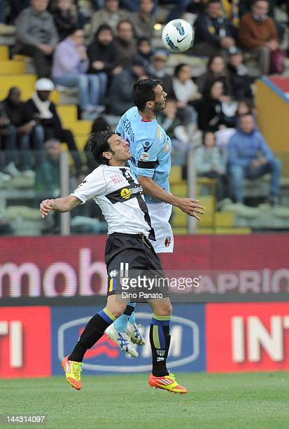Sergio Floccari of Parma competes in the air with Nicolo' Cherubin of Bologna during the Serie A match between Parma FC and Bologna FC at Stadio...