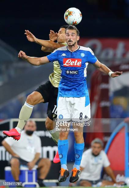 Sergio Floccari of SPAL and Fabian Ruiz of Napoli battle for the ball during the Serie A match between SSC Napoli and SPAL at Stadio San Paolo on...