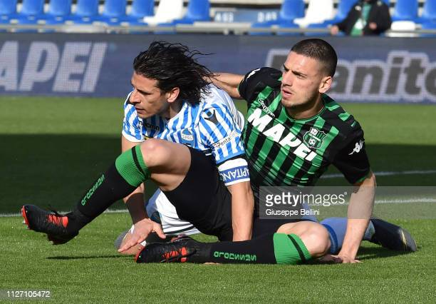 Sergio Floccari of SPAL and Merih Demiral of US Sassuolo in action during the Serie A match between US Sassuolo and SPAL at Mapei Stadium Citta' del...