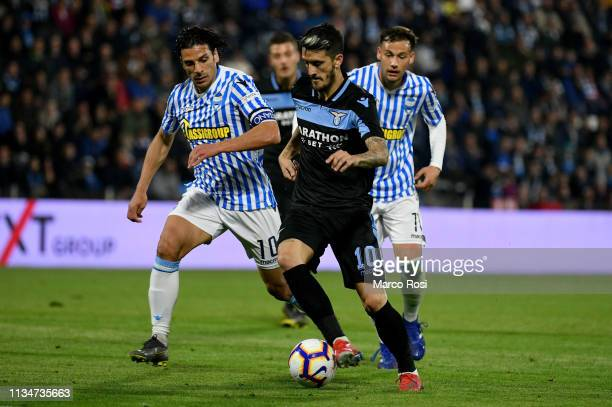 Sergio Floccari of Spal competes for the ball with Luis Alberto of SS Lazio during the Serie A match between SPAL and SS Lazio at Stadio Paolo Mazza...
