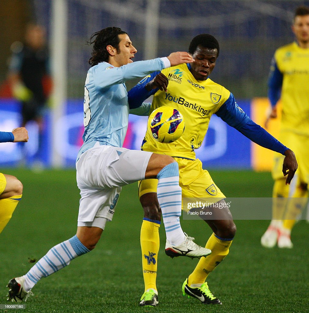 Sergio Floccari (L) of S.S. Lazio competes for the ball with Isaac Cofie of AC Chievo during the Serie A match between S.S. Lazio and AC Chievo Verona at Stadio Olimpico on January 26, 2013 in Rome, Italy.