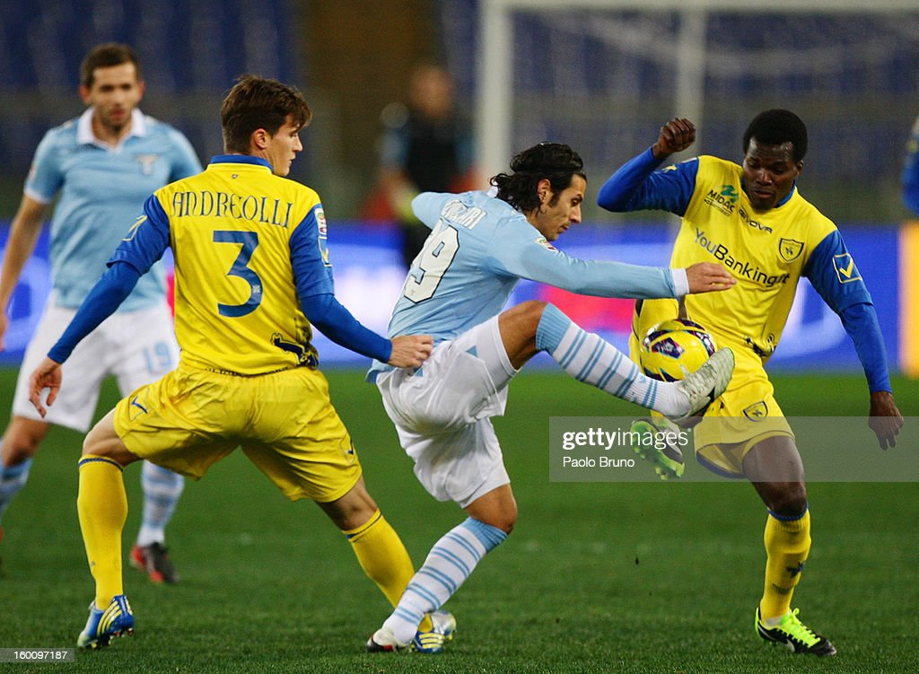 Sergio Floccari (C) of S.S. Lazio competes for the ball with Isaac Cofie (R) and Marco Andreolli of AC Chievo during the Serie A match between S.S. Lazio and AC Chievo Verona at Stadio Olimpico on January 26, 2013 in Rome, Italy.