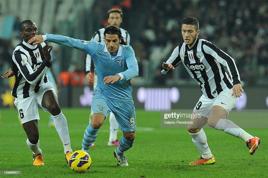 Sergio Floccari (C) of S.S. Lazio in action against Paul Pogba (L) and Luca Marrone of Juventus FC during the TIM cup match between Juventus FC and S.S. Lazio at Juventus Arena on January 22, 2013 in Turin, Italy.