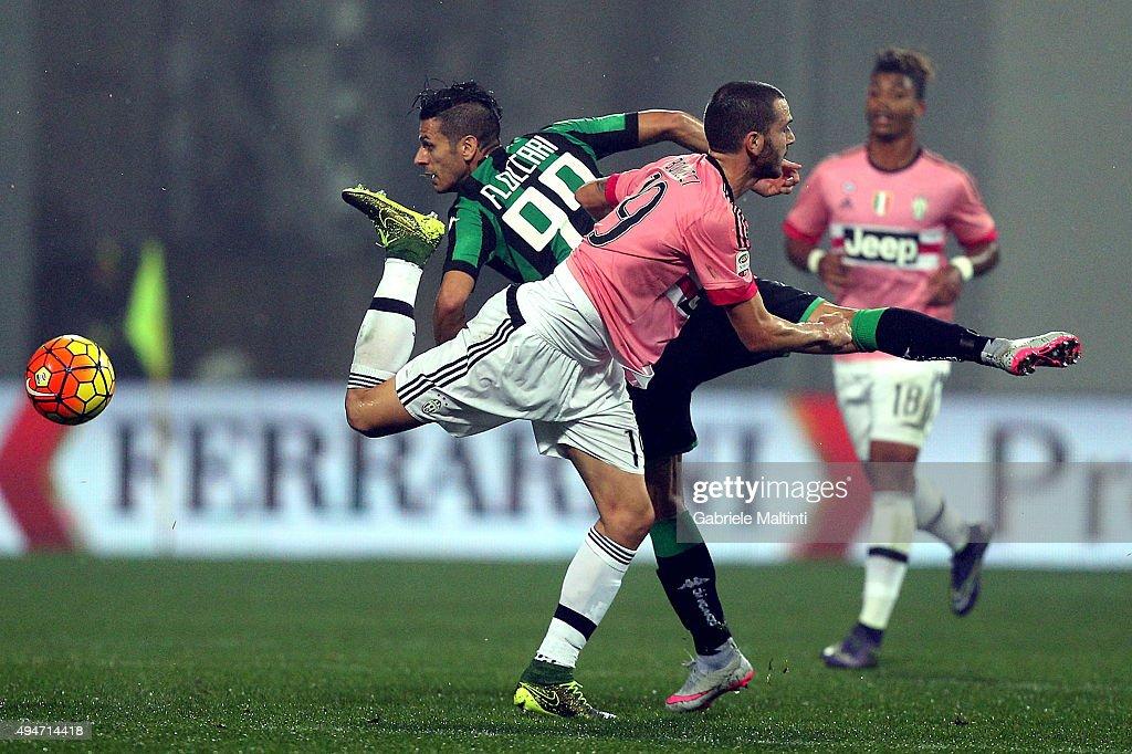 Sergio Floccari of US Sassuolo Calcio battles for the ball with Leonardo Bonucci of Juventus FC during the Serie A match between US Sassuolo Calcio and Juventus FC at Mapei Stadium - Città del Tricolore on October 28, 2015 in Reggio nell'Emilia, Italy.