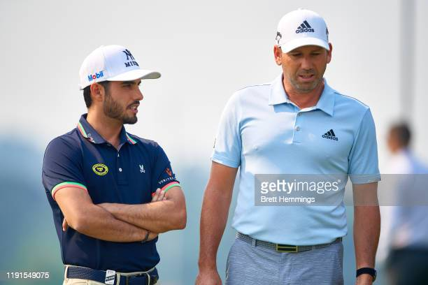Sergio García of Spain and Abraham Ancer of Mexico speak on the practice putting green during a practice round ahead of the 2019 Australian Golf Open...