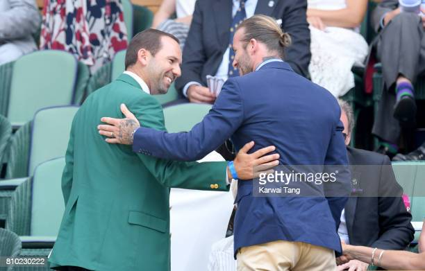 Sergio Garcia and David Beckham greet each other as they attend day 5 of Wimbledon 2017 on July 7 2017 in London England