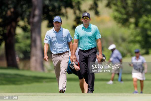 Sergio Garcia and Kevin Kisner walk up to the 8th green during the first round of the Charles Schwab Challenge on May 27, 2021 at Colonial Country...