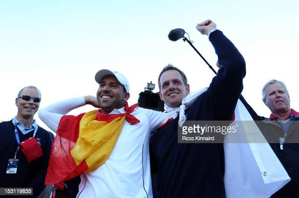 Sergio Garcia and Luke Donald celebrate after Europe defeated the USA 14.5 to 13.5 to retain the Ryder Cup during the Singles Matches for The 39th...