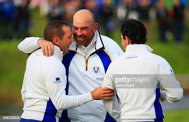 Sergio Garcia and Rory McIlroy of Europe celebrate victory on the 16th green with team mate Thomas Bjorn during the Afternoon Foursomes of the 2014...