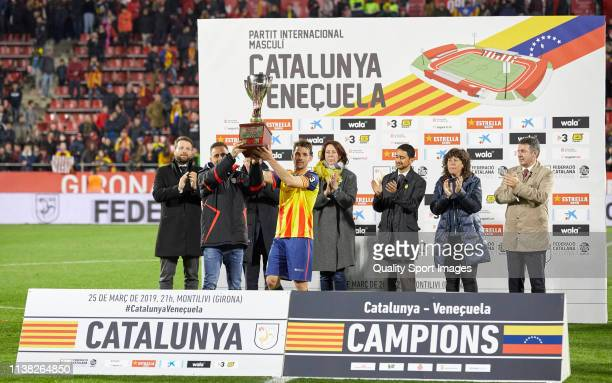 Sergio Garcia and Victor Sanchez of Catalonia receives the trophy of champions at the end of the International Friendly match between Catalonia and...