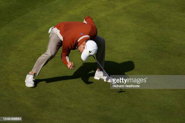 Sergio Garcia celebrates as he holes a putt on the 17th green to win the match during the morning fourball matches of the 2018 Ryder Cup at Le Golf...