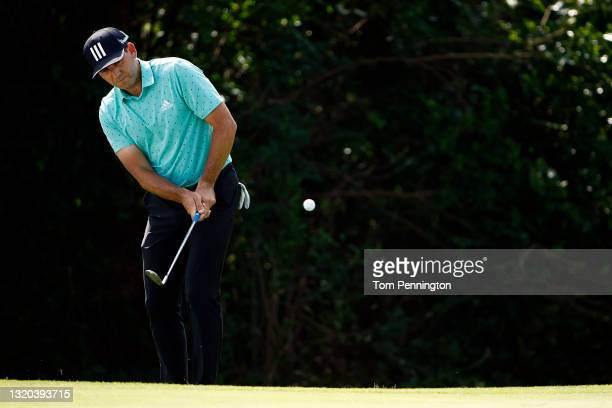Sergio Garcia chips on the 12th hole during the first round of the Charles Schwab Challenge at Colonial Country Club on May 27, 2021 in Fort Worth,...