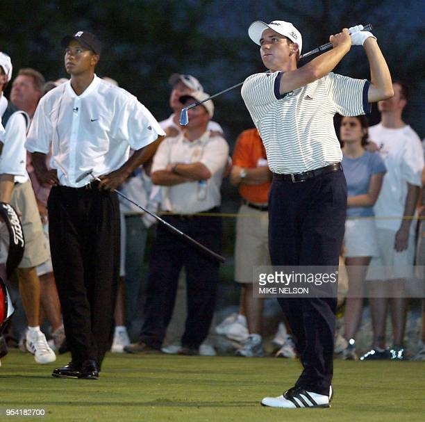 Sergio Garcia from Spain hits a tee shot on the 16th hole as Tiger Woods watches at the Battle at Bighorn 29 July 2002 at Palm Desert California...