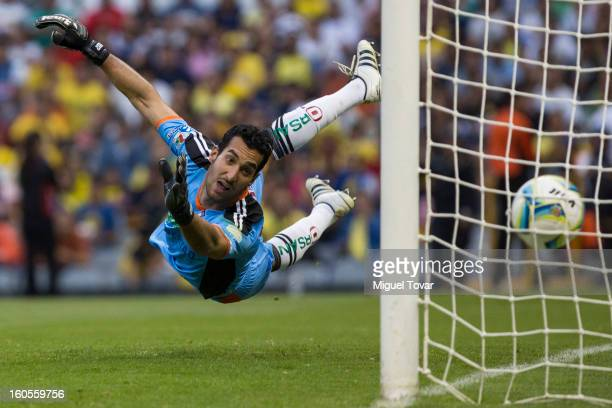 Sergio Garcia goalkeeper of Queretaro receives a goal of Raul Jimenez of America during a Clausura 2013 Liga MX match at Azteca Stadium on February...