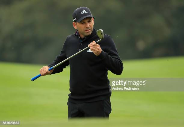 Sergio Garcia inspects his club on the 6th hole during the pro am ahead of the British Masters at Close House Golf Club on September 27 2017 in...
