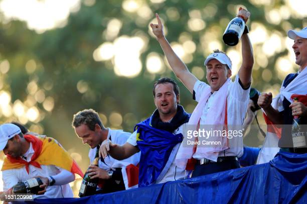 Sergio Garcia Luke Donald Graeme McDowell and Ian Poulter of Europe celebrate after winning The 39th Ryder Cup at Medinah Country Club on September...