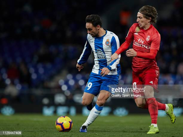 Sergio Garcia of Espanyol competes for the ball with Luka Modric of Real Madrid during the La Liga match between RCD Espanyol and Real Madrid CF at...
