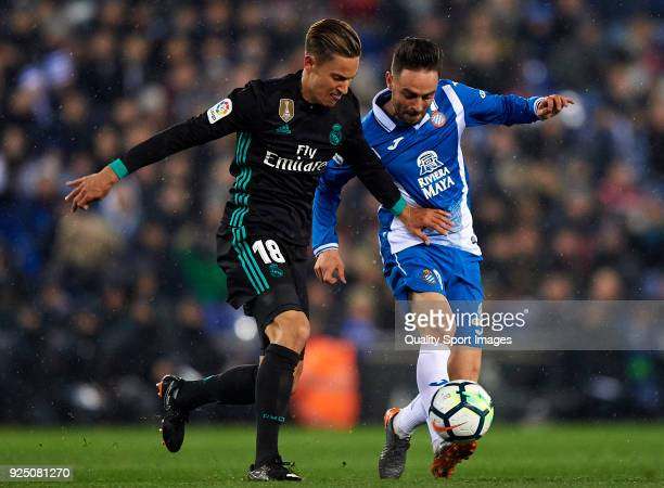 Sergio Garcia of Espanyol competes for the ball with Marcos Llorente of Real Madrid during the La Liga match between Espanyol and Real Madrid at...