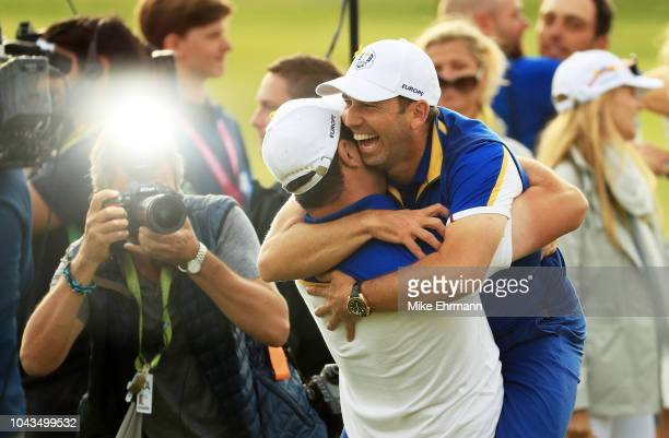 Sergio Garcia of Europe and Jon Rahm of Europe celebrates after winning The Ryder Cup during singles matches of the 2018 Ryder Cup at Le Golf...