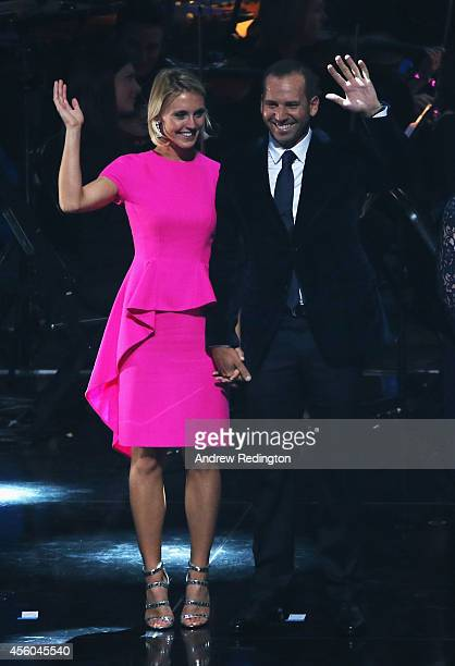 Sergio Garcia of Europe and Katharina Boehm wave during the 2014 Ryder Cup Gala Concert at the SSE Hydro on September 24 2014 in Glasgow Scotland