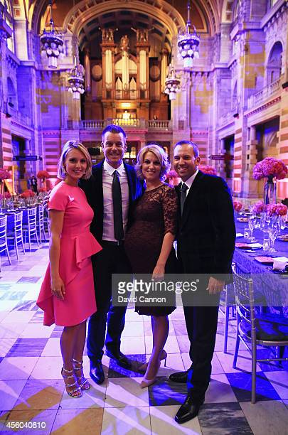 Sergio Garcia of Europe and partner Katharina Boehm pose with Henrik Stenson of Europe and wife Emma Stenson during the 2014 Ryder Cup Gala Dinner at...