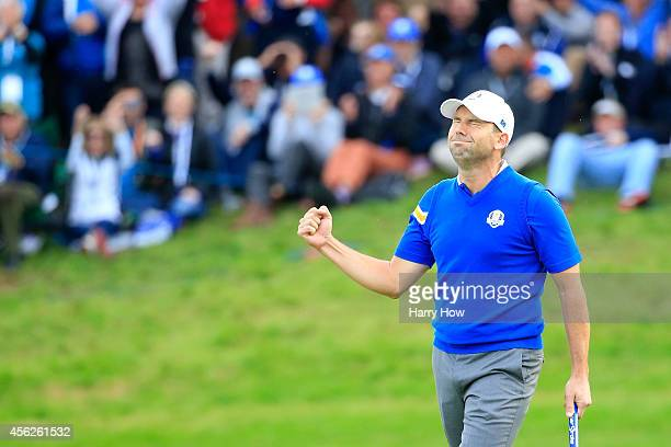 Sergio Garcia of Europe celebrates winning the 16th hole during the Singles Matches of the 2014 Ryder Cup on the PGA Centenary course at the...