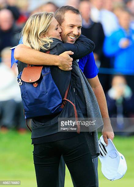 Sergio Garcia of Europe celebrates with Katharina Boehm during the Singles Matches of the 2014 Ryder Cup on the PGA Centenary course at the...