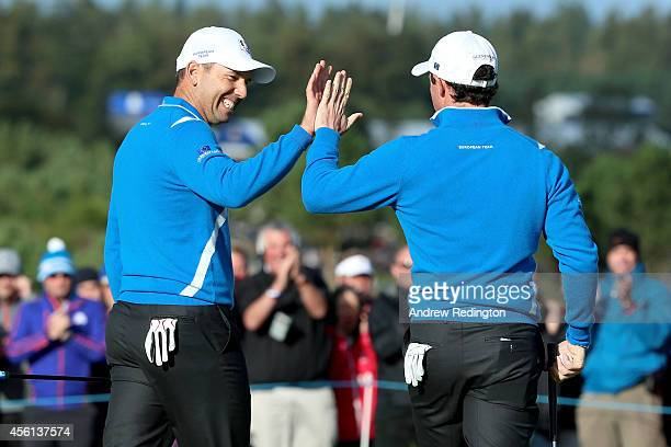 Sergio Garcia of Europe congratulates Rory McIlroy after his putt on the 8th green during the Afternoon Foursomes of the 2014 Ryder Cup on the PGA...