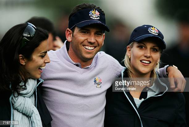 Sergio Garcia of Europe is hugged by Henrik Stenson's girlfriend Emma Lofgren and Luke Donald's fiancee Diane Antonopoulos during the afternoon...