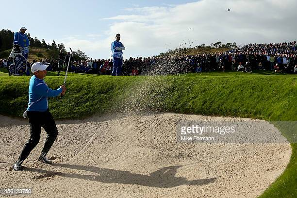 Sergio Garcia of Europe plays from a bunker on the 8th hole during the Morning Fourballs of the 2014 Ryder Cup on the PGA Centenary course at the...