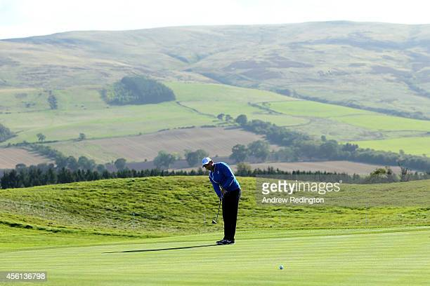 Sergio Garcia of Europe putts on the 3rd green during the Afternoon Foursomes of the 2014 Ryder Cup on the PGA Centenary course at the Gleneagles...