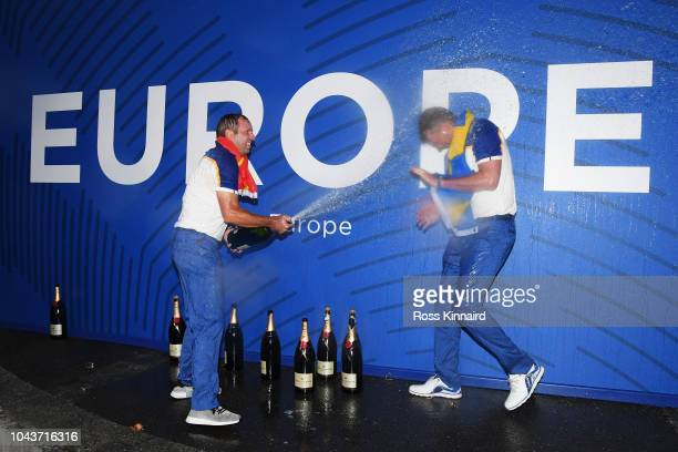 Sergio Garcia of Europe sprays champagne over Henrik Stenson of Europe after they win The Ryder Cup following singles matches of the 2018 Ryder Cup...