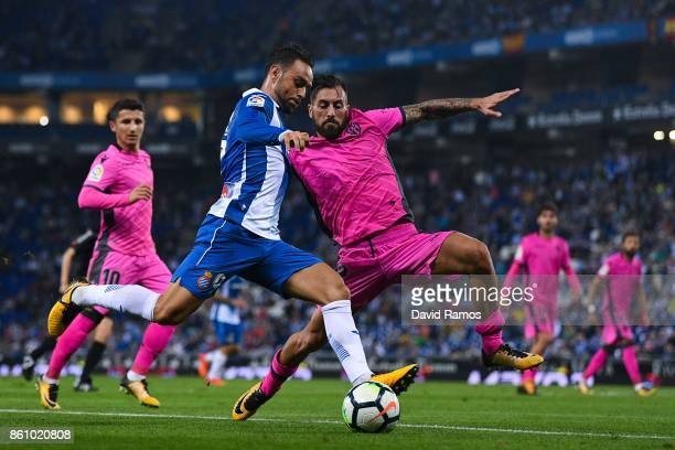 Sergio Garcia of RCD Espanyol competes for the ball with Antonio Luna of Levante UD during the La Liga match between Espanyol and Levante at...