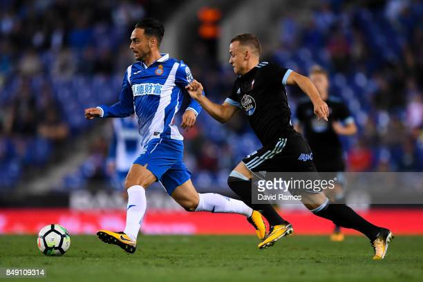 Sergio Garcia of RCD Espanyol competes for the ball with Stanislav Lobotka of RC Celta de Vigo during the La Liga match between Espanyol and Celta de...
