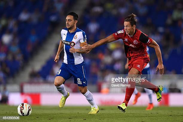 Sergio Garcia of RCD Espanyol duels for the ball with Grzegorz Krychowiak of Sevilla FC during the La Liga Match between RCD Espanyol and Sevilla FC...