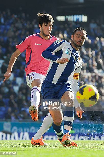 Sergio Garcia of RCD Espanyol duels for the ball with Marc Valiente of Real Valladolid CF during the La Liga match between RCD Espanyol and Real...