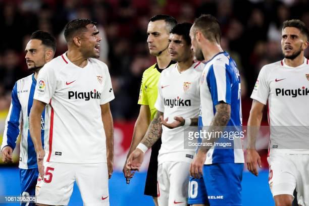 Sergio Garcia of RCD Espanyol Gabriel Mercado of Sevilla FC Jaime Latre referee Ever Banega of Sevilla FC Sergi Darder of RCD Espanyol Sergi Gomez of...