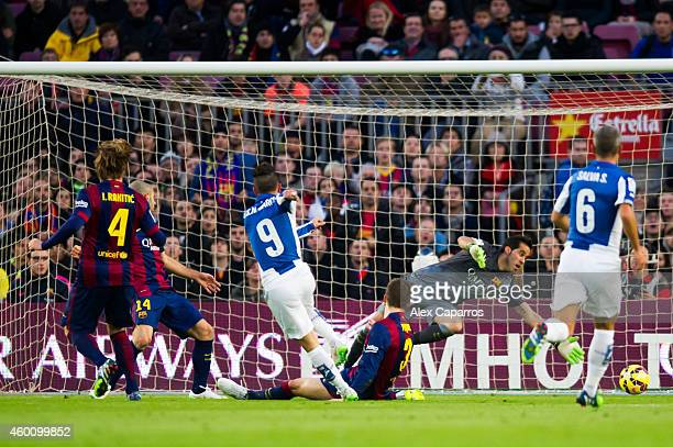 Sergio Garcia of RCD Espanyol scores the opening goal during the La Liga match between FC Barcelona and RCD Espanyol at Camp Nou on December 7 2014...