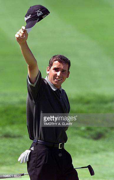 Sergio Garcia of Spain acknowledges the gallery after his final putt on the 18th hole to win the 2001 Buick Classic 25 June at the Westchester...