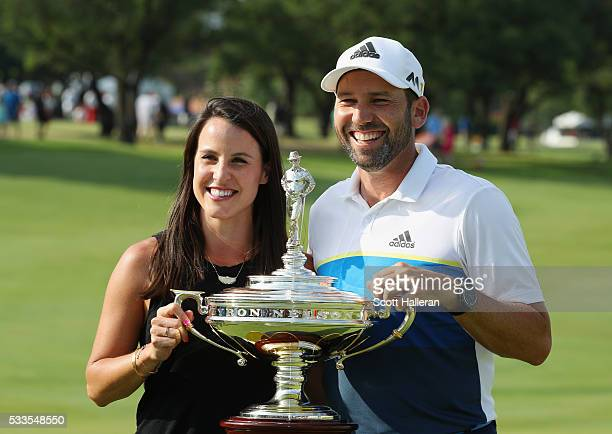 Sergio Garcia of Spain and Angela Akins pose with the trophy after winning the ATT Byron Nelson at the TPC Four Seasons Resort on May 22 2016 in...
