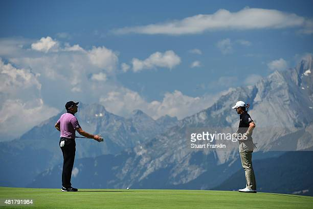 Sergio Garcia of Spain and Bernd Wiesberger of Austria react during the first round of the Omega European Masters at CranssurSierre Golf Club on July...